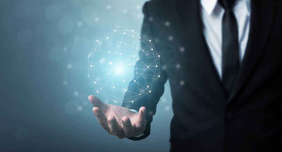 Man in suit holding network sphere