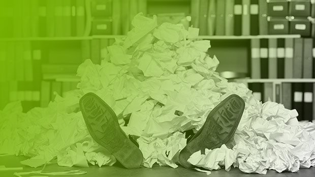Man buried under a pile of paper